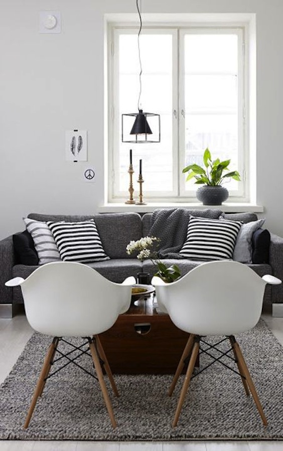 grey sofa and white eames chairs