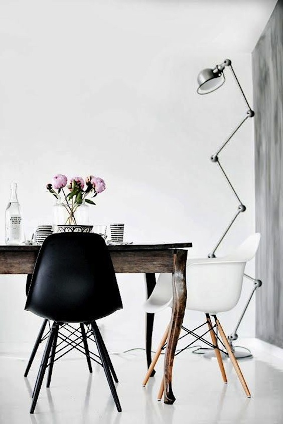 rustic table and black eames chair