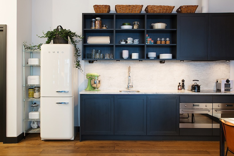 black kitchen and smeg